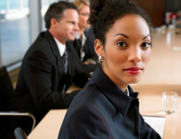 Portrait of a Businesswoman Sitting in a Meeting at a Conference Room Table