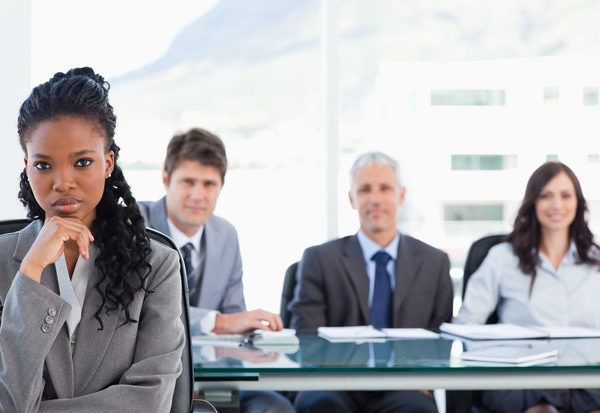 businesswoman-sitting-with-her-hand-on-her-chin-in-front-of-her-team-in-a-meeting-room151016166-100264768-primary-idge