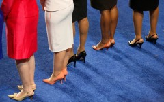 The legs of five women members of the U.S. House of Representatives are seen during the opening session of the 2012 Democratic National Convention in Charlotte