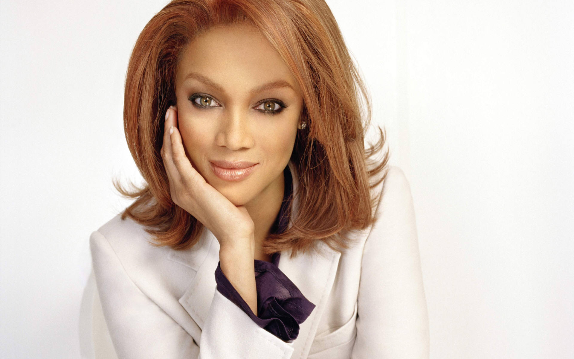 Tyra Banks is an American television personality, producer, businesswoman, actress, author, former model and occasional singer. Born in Inglewood, California, she began her career as a model at age 15, and was the first African American woman to be featured on the covers of GQ and the Sports Illustrated Swimsuit Issue, on which she appeared twice. She was a Victoria's Secret Angel from 1997 to 2005. By the early 2000s, Banks was one of the top-earning models in the world.